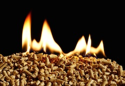 Burning wood pellets in biomass boiler