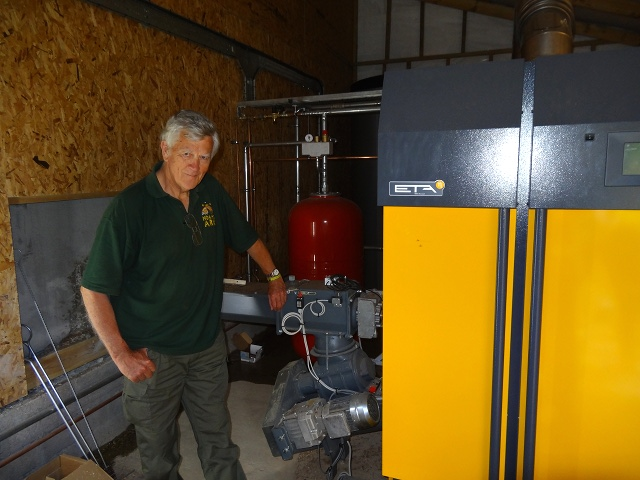 A proud new owner poses with his biomass boilers