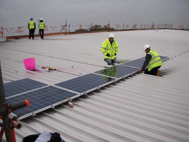 Fitting the solar pv panels to Swindon New College roof